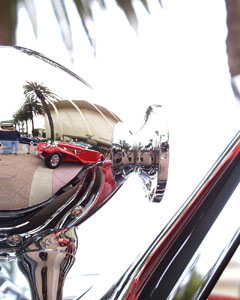 Reflection of a Mercedes-Benz 540 K Cabriolet A in the searchlight of a 540 K Special Roadster